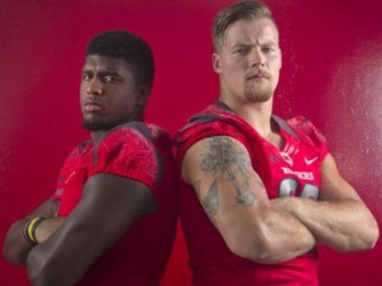 Captains Darius Hamilton (left) and David Milewski know that Rutgers football has something to prove as it enters the Big Ten. (Jason Towlen/Staff photographer)