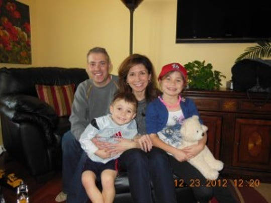 Mike and Tammy McDill with their children Trevor and Sydney.