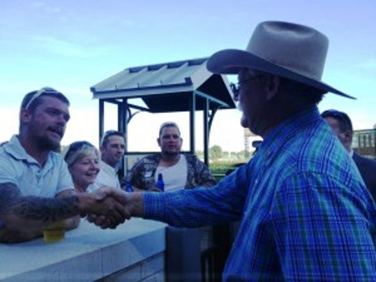 Fans by the winner's circle congratulated Steve Coburn, praised California Chrome's Triple Crown run and some wanted his autograph at Churchill Downs Saturday evening.