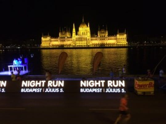 Budapest Night Run overlooking the Danube river with the Parliament building in the background.