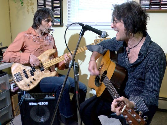 John (left) and Steve Conte perform together in the