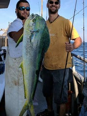 Freddie Reisel, left, from Pennsburg, Pennsylvania with a 14-pound mahi-mahi he caught on the 125-foot Jamaica party boat on Labor Day 2017.