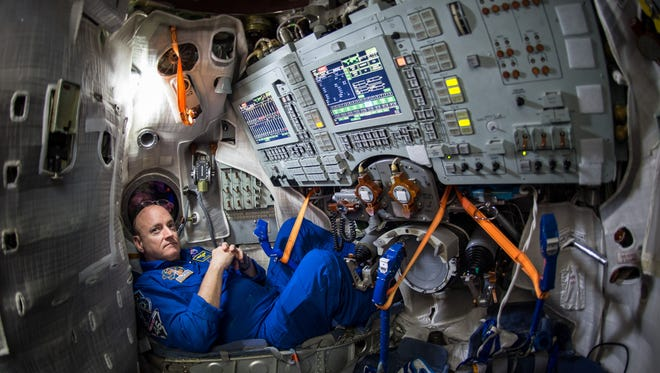 In this photo provided by NASA, astronaut Scott Kelly sits inside a Soyuz simulator at the Gagarin Cosmonaut Training Center (GCTC), Wednesday, March 4, 2015 in Star City, Russia. On Friday, March 28, 2015, Kelly and cosmonaut Mikhail Kornienko will travel to the International Space Station to begin a year-long mission living in orbit. (AP Photo/NASA, Bill Ingalls)