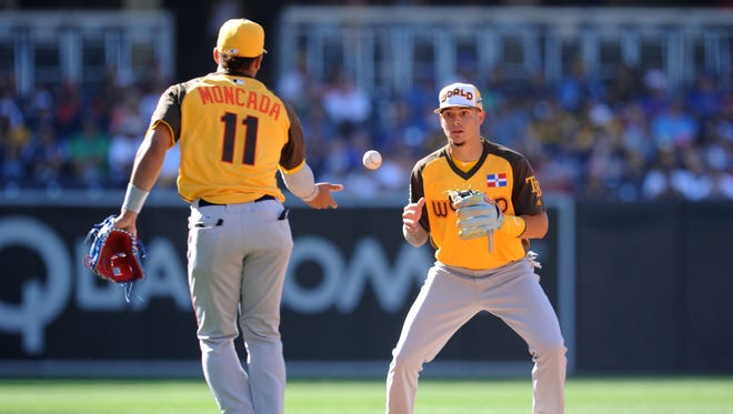 Shortstop prospect Willy Adames, right, represented the World team at the 2016 All-Star Futures Game.
