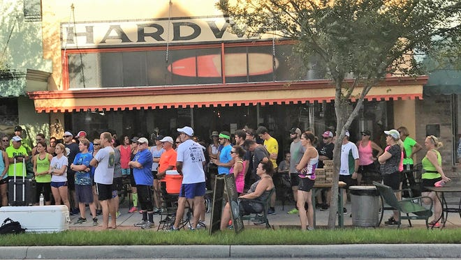 Runners gather outside Playalinda Brewing Company in downtown Titusville before a 2017 Summer Brewery & Running Tour run.