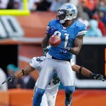 Detroit Lions wide receiver Calvin Johnson makes a catch for a first down in front of Miami Dolphins safety Tyrone Culver on Dec. 26, 2010.