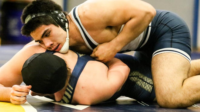 Colonia's Adrian Najar wrestles New Brunswick's Jovan Mercado during the 220 pound match at Colonia High School on Wednesday.