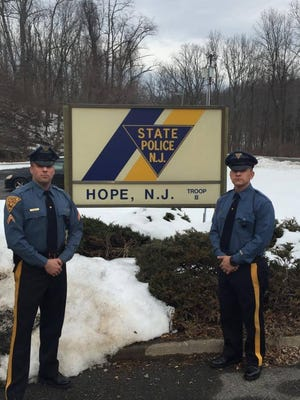 New Jersey State Troopers Jordan Siegel, left, and Corey Smith rescued more than a dozen farm animals from a barn fire in Hope township on Jan. 30, 2016.