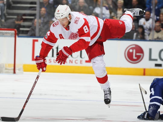 Red Wings' Justin Abdelkader is sent flying by the