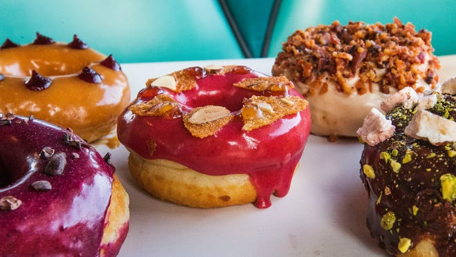 Welcome Chicken+Donuts in Phoenix offers doughnut flavors including blueberry cacao, peanut butter and blackberry liqueur, cherry amaretto, maple bacon and chocolate rose pistachio.