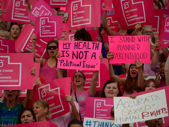 This Aug. 25, 2015, file photo, Planned Parenthood Action Council holds a community rally at the state Capitol, in Salt Lake City. A federal appeals court is ordering Utah to continue sending money to the state branch of Planned Parenthood, overturning an earlier ruling that allowed the governor to defund the organization.
