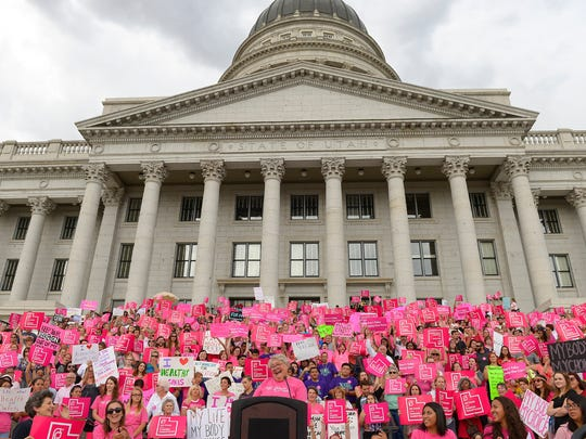This Aug. 25, 2015, file photo, Karrie Galloway, CEO of Planned Parenthood Action Council, laughs as the roar of the crowd drowns out her speech at the state Capitol, in Salt Lake City.