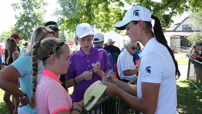 Lindsey McPherson signs autographs after she finished the second round of the Meijer LPGA Classic on June 17, 2016 at Blythefield Country Club in Belmont, Michigan.