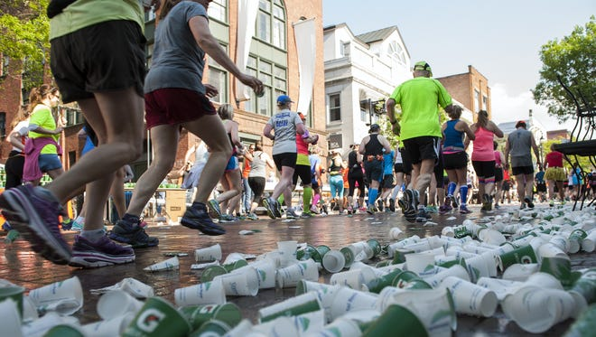 Marathon runners shed paper cups during a race in  Burlington, Vermont. Trail racers would take the cups with them — if there were cups at all.