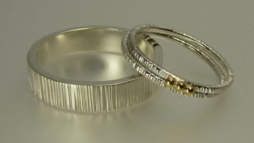 The sterling silver Trevett wedding ring, and Boothbay sterling and 18K gold set