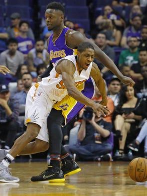 Phoenix Suns guard Brandon Knight (11) falls to the