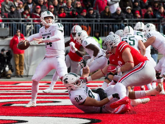 MSU quarterback Brian Lewerke found himself under duress throughout last year's 48-3 loss to Ohio State in Columbus.