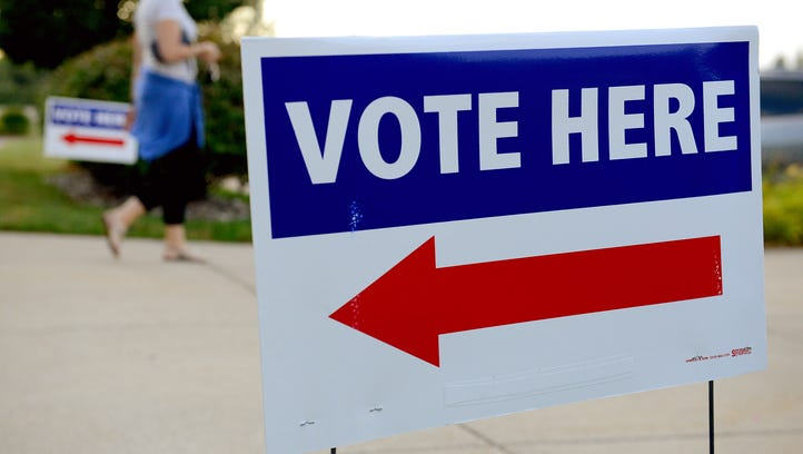 A voter leaves her polling place after casting his