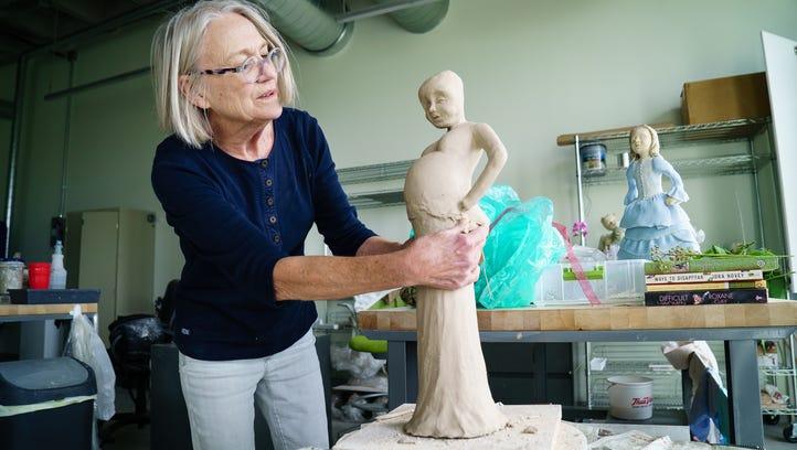 Ceramic artist Judy Goodwin works on a new sculpture