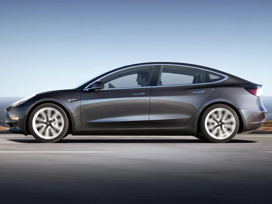 Tesla delays volume production of Model 3 by three months, reports massive loss