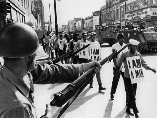 National Guard bayonets block Memphis' famed Beale Street March 29, 1968 as marchers supporting striking sanitation workers pass through downtown.