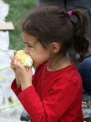 Lily Martins, 4, from Croton-on-Hudson, eats her ear