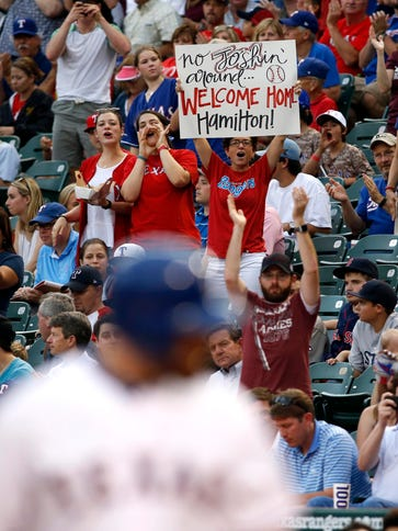 Rangers fans hold up a sign for Josh Hamilton during