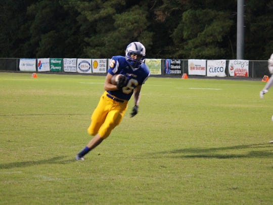 Tucker Adkins (16) runs for a touchdown against the Bolton Bears.