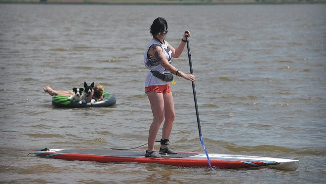 Kayla Strickland cruises along on a standup paddleboard Tuesday afternoon at Lake Wichita.