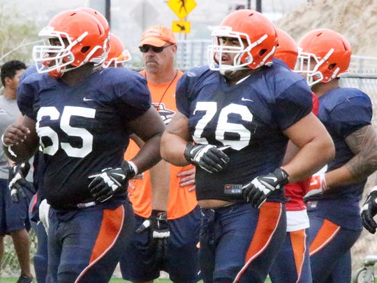 UTEP offensive linemen Derron Gatewood, 65; Will Hernandez, 76; and Jerome Daniels, 70, work out during a practice at Glory Field. Hernandez has decided to pass up a chance at the NFL this year and instead play another season for the Miners.