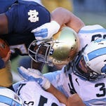 North Carolina's Nathan Staub brings down Notre Dame's Everett Golson during Saturday's game.