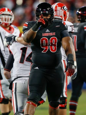 Louisville defensive lineman Sheldon Rankins celebrates after sacking Georgia's Hutson Mason in the first quarter of the Belk Bowl. Dec. 30, 2014
