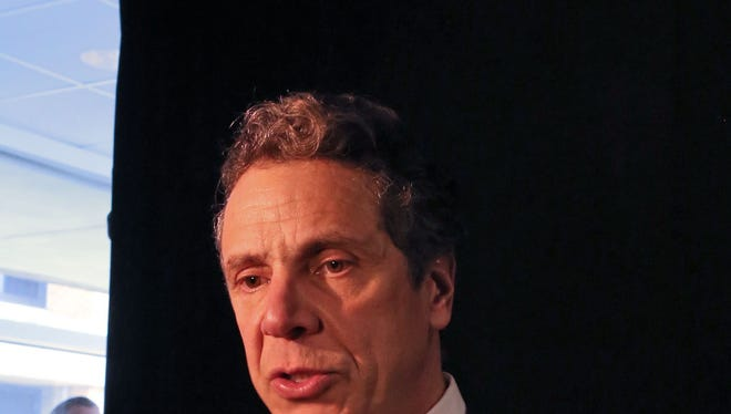 New York Gov. Andrew Cuomo talks to the media after speaking about his plan to reduce property taxes statewide during a visit to Rockland Community College March 19, 2014.