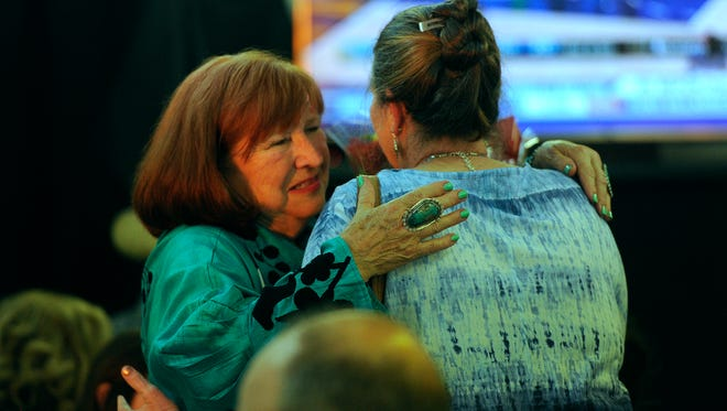 Abilene City Council candidate Donna Albus (left) gets a hug from supporter Donna Reiff during Albus's campaign party on Saturday, May 6, 2017.