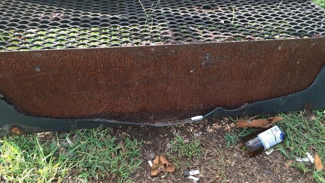 Bottles, cigarette butts, broken plastic and rusty equipment are some of the concerns parents have at the Beverly Street playground in Barnegat. Some residents say the township's parks are in dangerous disrepair.
