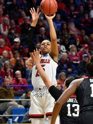 Mar 23, 2018; Lexington, KY, USA; Louisville guard Asia Durr (25) shoots over Stanford guard Marta Sniezek (13) during the first half in the semifinals of the Lexington regional of the women's basketball NCAA Tournament at Rupp Arena.