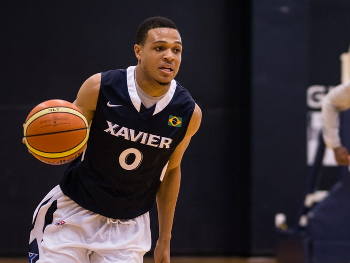 Freshman guard Larry Austin Jr. dribbles down the court during a Xavier practice drill on Monday.