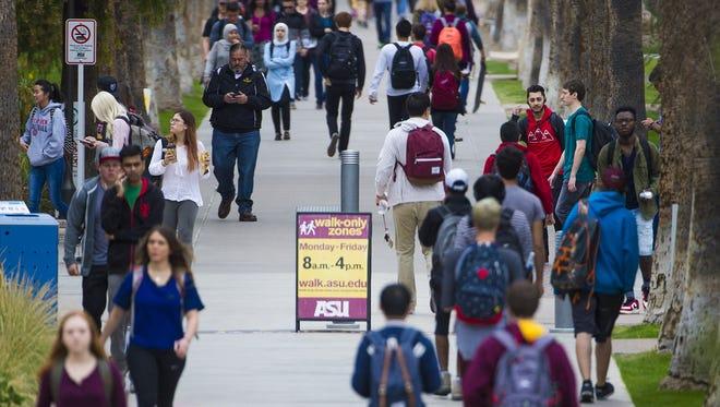 Arizona State University students walk between classes Feb. 6, 2017.
