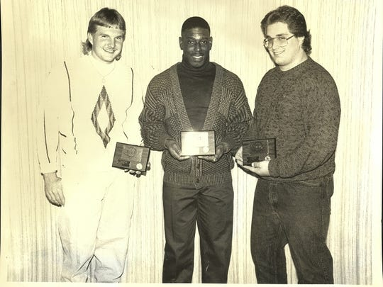 Iowa Wesleyan football players Dustin Dewald, left, Chris Edwards and John Coneset  at 1989 IWC Awards Banquet.