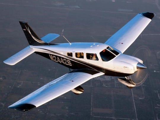 A Piper Archer airplane.