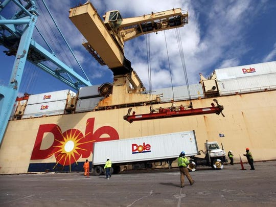 Longshoremen help unload a Dole shipment in March at the Port of Wilmington.