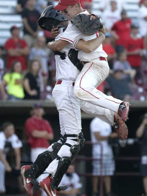 Kimberly High School's catcher #17 Beau Schumacher and pitcher #25 Ryan Carney  embrace at the plate following the Papermakers 4-2 victory over Sun Prairie High School during the 2017 WIAA Division 1 Spring Baseball Tournament championship baseball game on Thursday, June 15, 2017 at Neuroscience Group Field at Fox Cities Stadium in Grand Chute, Wis.