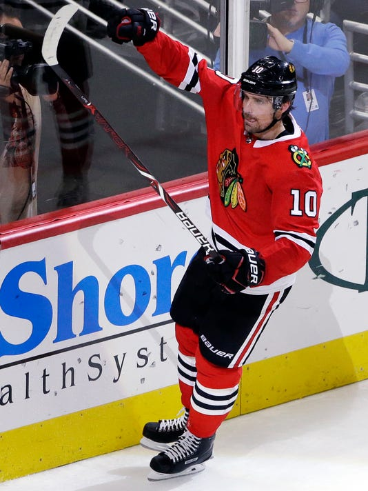 Chicago Blackhawks left wing Patrick Sharp celebrates after scoring a goal against the Nashville Predators during the third period of an NHL hockey game Saturday, Oct. 14, 2017, in Chicago. (AP Photo/Nam Y. Huh)