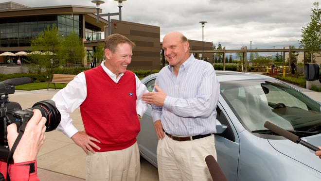 A 2009 photo of Ford CEO Alan Mulally at the Microsoft headquarters campus to give Microsoft CEO Steve Ballmer a new 2010 Fusion Hybrid equipped with the 1 millionth Ford SYNC system, the voive-activated infotainment system using Microsoft software.
