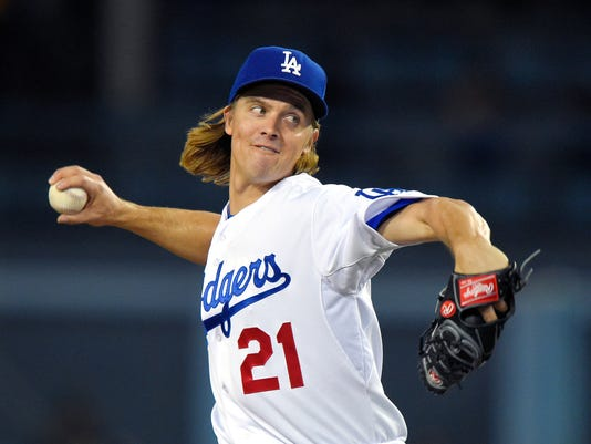 FILE - In this Sept. 18, 2015, file photo, Los Angeles Dodgers starting pitcher Zack Greinke throws to the plate during the first inning of a baseball game against the Pittsburgh Pirates in Los Angeles.  Zack Greinke and the Arizona Diamondbacks have finalized their $206.5 million, six-year contract, a deal with a $34.4 million average salary that is the highest in baseball history. (AP Photo/Mark J. Terrill, File)