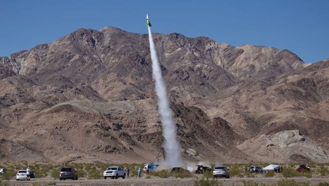 Mike Hughes's homemade rocket launches near Amboy, Calif., on Saturday. The self-taught rocket scientist, who believes Earth is flat, propelled himself about 1,875 feet into the air before a hard landing in the Mojave Desert.