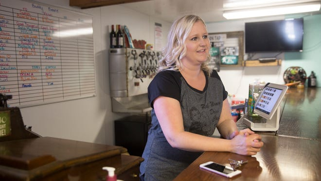 Manager Kara Paschall speaks about the 550 Brewing's new Sunday hours during an interview on Thursday.