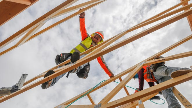 Construction workers Raymond Begay, left, and Creighton Curley work Tuesday on a new building near the Tsé Alnaozt'i'í Chapter house in Sanostee.