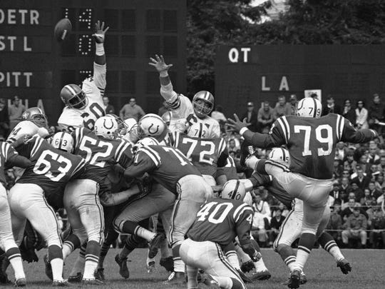 Lou Michaels, right, attempts a field goal for the Baltimore Colts during a 1967 game against the San Francisco 49ers. Michaels, a Staunton Military Academy graduate, died Jan. 19 at the age of 80.
