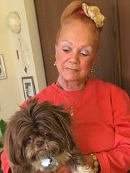 Russi Arden, 77, of Southfield with her dog, Chewie.